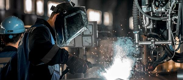 Welder In Manufacturing Plant