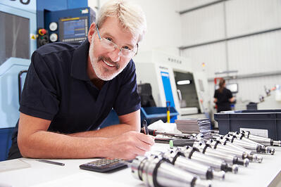 CNC machine shop worker - SEO