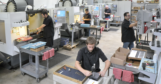 CNC machine shop workers