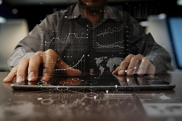businessman hand working on laptop computer with digital layer business strategy and social media diagram on wooden desk.jpeg