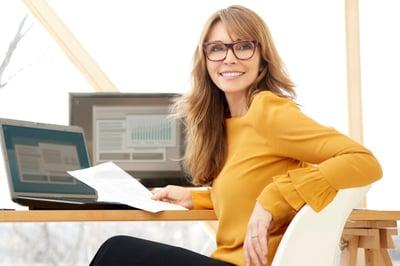 Smiling woman at a computer