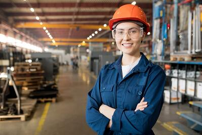 Smiling female engineer in a warehouse