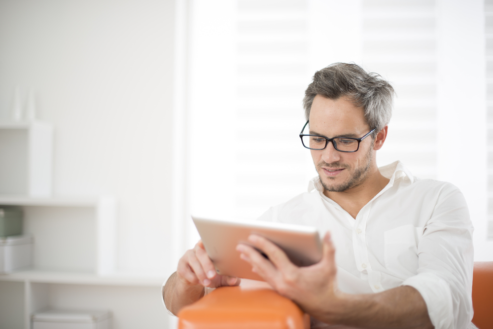 reading newsletter on tablet