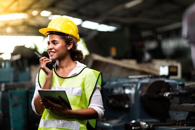 female minority industrial worker with a tablet