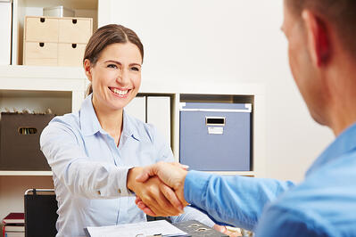 shaking customer hand - turning lead to a customer