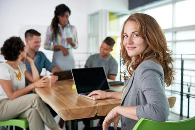 Smiling businesswoman at a computer