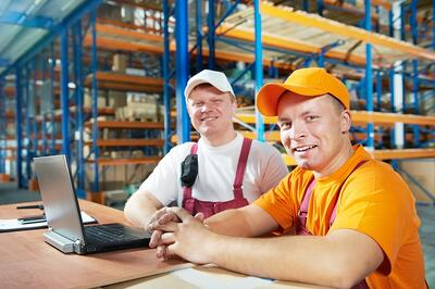 Two workers sourcing in a warehouse
